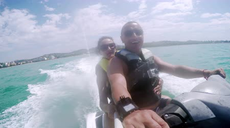 esqui : Jet ski fun recreation of young couple enjoying summer time. Jetski sport race