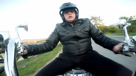 lovas : Young man driving motorbike. POV, original point of view