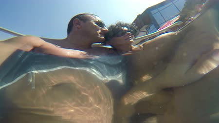 hot tub : Couple in spa pool underwater view