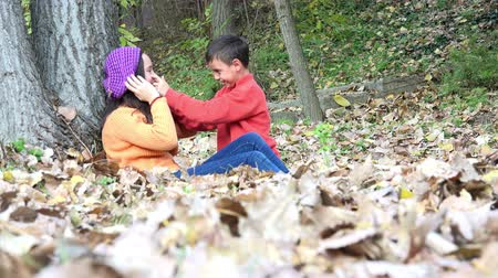 o : Brother and sister change feelings playing, and kissing in autumn forest