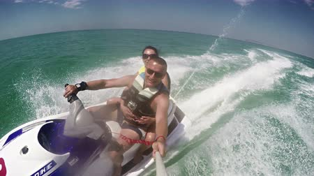 water jet : Young Couple on Jet Ski, Tropical Ocean, Vacation Concept