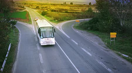 автобус : Road with bus traffic driving fast at sunset