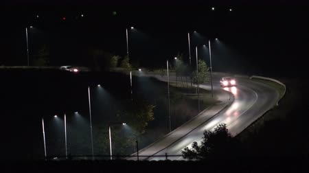 streaking : Aerial View of heavy traffic jam highway, Timelapse of driving  cars racing by with streaking lights trail at night