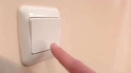 comutar : Electric switch is turned on and off Stock Footage