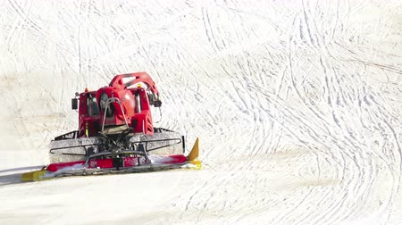 snowcat : Red machine for summer skiing slope preparations Stock Footage
