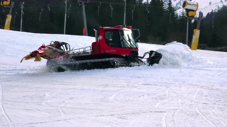 snowcat : Snowcat preparing a slope at skiing resort