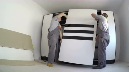 self storage : Carpenters make wardrobe furniture assembly timelapse