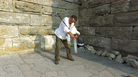 felvidéki : Street performer play music on bagpipes at Old Town castle in Nessebar, Bulgaria