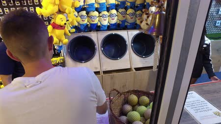 frightful : Fair goers try their luck at arcade games on boardwalk