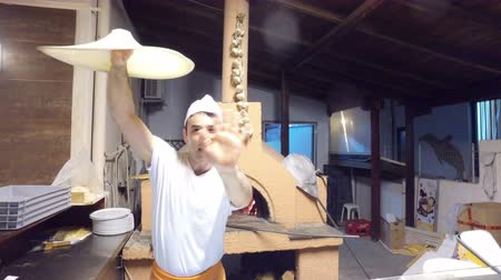 hamur : Arthistic chef performance, acrobatic preparing dough for pizza