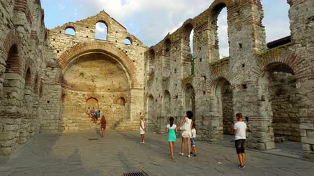 bulgary : People are strolling around famous church in nesebar - Saint Sophia - UNESCO World Heritage Site. Stock Footage