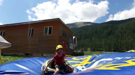 stimulating : Summer Tubing atraction Park with jump replaces winter snow sliding Stock Footage