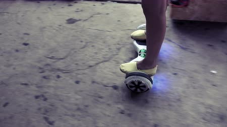 two wheeled : Girl feet on the hover board POV Stock Footage