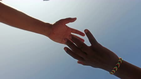 equal : Equality handshake of two multicultural race people Stock Footage
