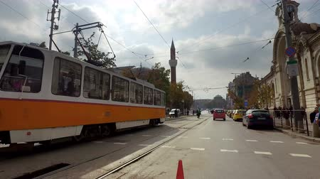 banja : Drive pov on Sofia road with view of tram and Banya Bashi Mosque