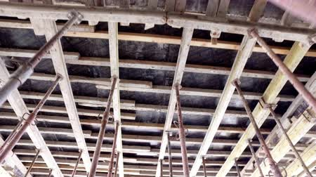 ограждение : Residental building ceiling reconstruction. Worker pov moving on construction site, Formwork ceiling systems