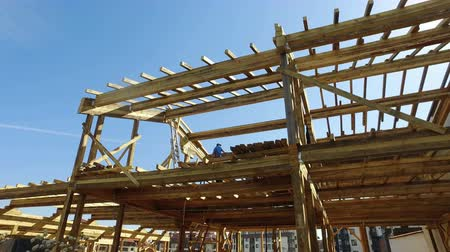 post and beam construction : New construction of a houseFramed New Construction of a HouseBuilding a new house from the ground up Stock Footage