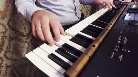 piano parts : Music playing on Keyboard piano, closeup Stock Footage
