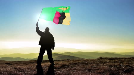 conquest : Successful silhouette man winner waving Zambia flag on top of the mountain peak, Cinemagraph LOOP background