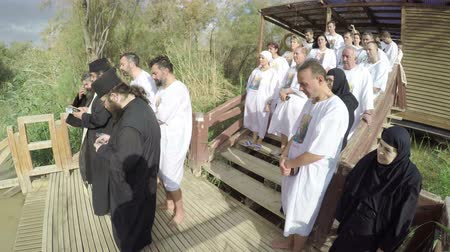 baptized : Christian pilgrims during baptism ceremony at the Jordan River in North Israel.In Christian tradition  Jesus was baptised in the River Jordan by John the Baptist