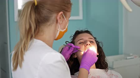 painless : Overview of dental caries prevention.Woman at the dentist�s chair during a dental procedure Stock Footage