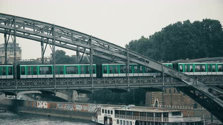 bir hakeim : PARIS  FRANCE  circa MAY  2017. New metro train MF2000 traveling on line 5 of the Paris subway network over Austerlitz bridge