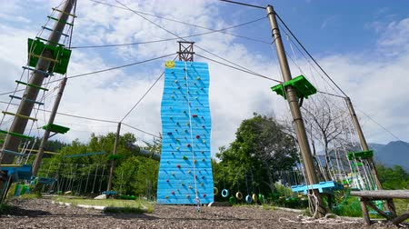 bravery : Climbing rock wall outdoors, Adventure park timelapse