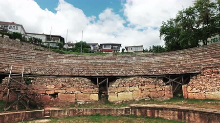 актер : Old amphitheater in Ohrid, Macedonia. Ohrid summer festival is held here and a lot of worlds classic music arthists are making their performances in this aquistic place Стоковые видеозаписи