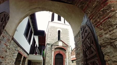 ohrid : Entrance pov through ancient Holy Mary Perybleptos church arch door with view of bell tower in Ohrid Macedonia