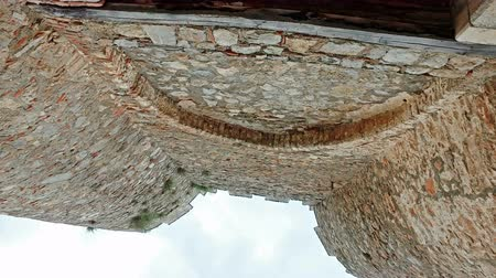 ohrid : Tourist pov movement under ancient gate at tzar Samuil ruined fortress in Ohrid, Macedonia, cinemati shot