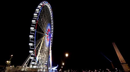 Illuminated ferris wheel in Concorde at night
