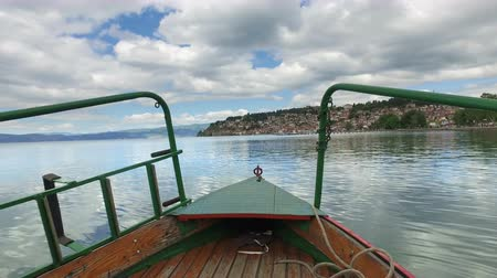 ohrid : Tourist boat ride pov, front view of cruising on Ohrid lake, Macedonia with background view of town architecture