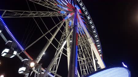 Wonderful ferris wheel in Paris by night Stock Footage