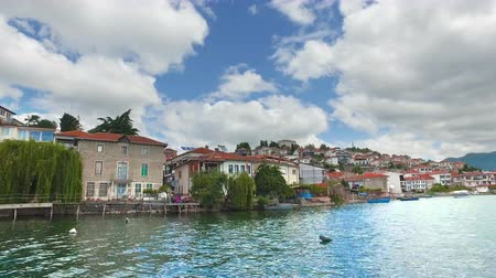 Tourist boat ride on Ohrid lake with view of traditional house architecture and old town