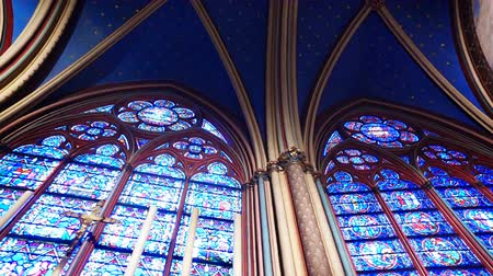 Virtrage windows of interior of gothic church Notre Dame from Paris Stock Footage