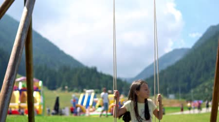 dominik : Girl Plays On Swing in Slow motion, cinematic dof
