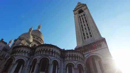 látnivalók : Cinematic view of Basilica Sacre Coeur in Montmartre in Paris, France