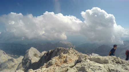 rochoso : The top of the highest mountain of Slovenia - Triglav, 2864 m, in the late summer. As usually when the weather is nice, there was many visitors