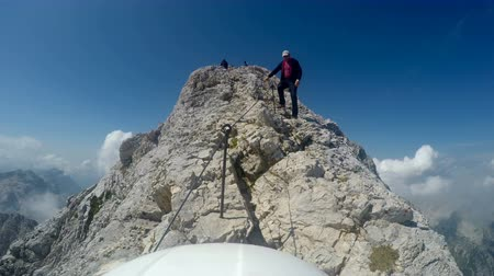 mounted : Mountaineer pov from camera mounted on helmet from climbing expedition to the top of the highest mountain of Slovenia - Triglav, 2864 m, in the late summer
