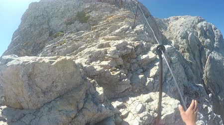 turizm : Mountaineer pov to expedition climbing to rocky mountain summit Triglav on Julian Alps mountain range Stok Video