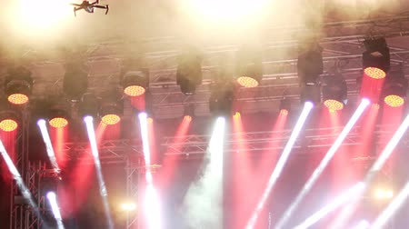 színpadi : Concert stage colorful led light and drone silhouette recording video