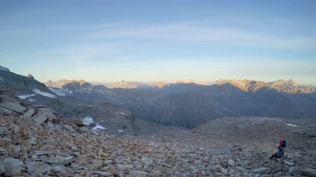 오후에 : Panning view of rocky stone mountain range at sunset on French alps during Mont Blanc expedition 무비클립