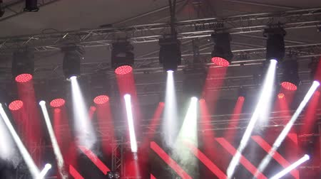 reflektör : Illuminated concert stage with smoke and red led reflector beams Stok Video