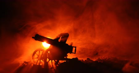 bulletproof : Maxim gun in 1910 sample year. After battle scene with fog. orange background Stock Footage
