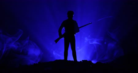 coalition : Army sniper with large-caliber sniper rifle seeking killing enemy. Silhouette on sky background. National security ensured, servicemen on guard. Battle scene