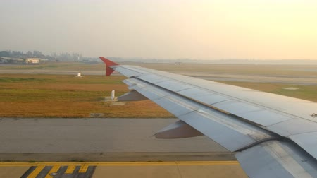 ponta : Airplane taxiing on runway at airport in morning, view through from window