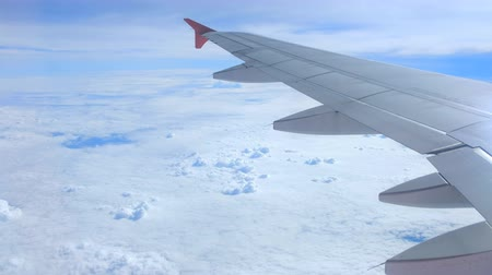 aeroespaço : Airplane is flying above the clouds, view through from window