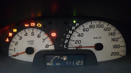 kilometer : Modern car illuminated dashboard closeup Stock Footage