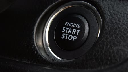 motoryzacja : Engine start stop button from a modern car interior Wideo