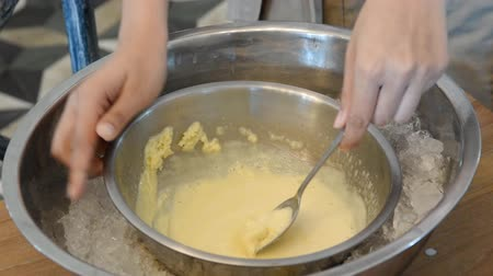 part of clip : ice cream being stirred over a bain marie Stock Footage